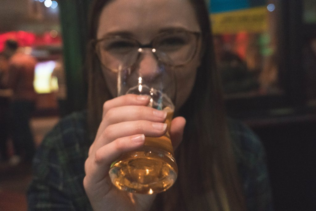 Addie drinking Cider at Sober Lane in Cork City Ireland