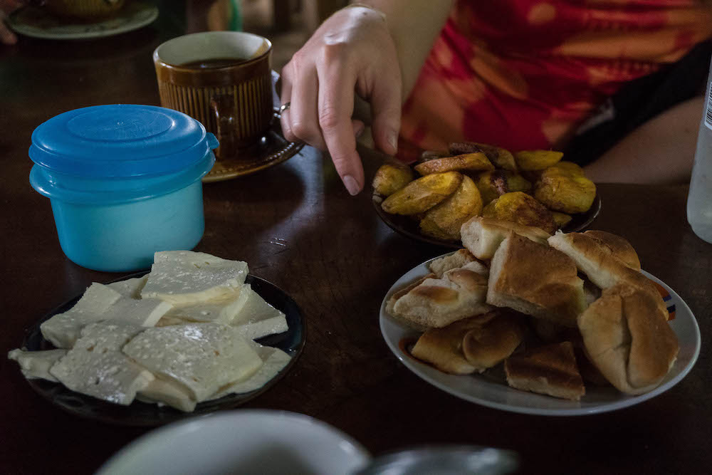Hand grabbing a fried Plantain at Don Pedro's in La Fortuna, Costa Rica