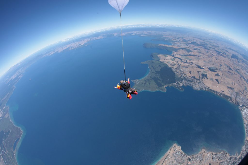 Girl skydiving in New Zealand
