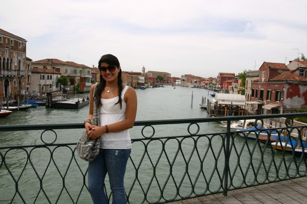 Girl smiling on a bridge while studying abroad in Italy