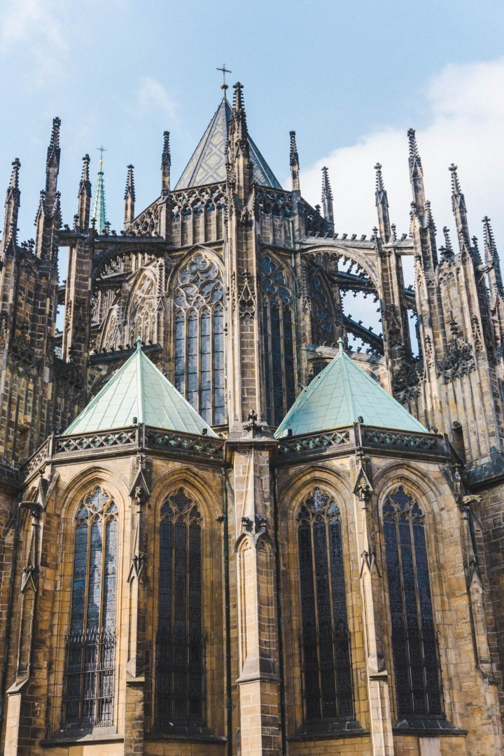 A tight shot of the outside of the intricate gothic St Vitus Cathedral at Prague Castle
