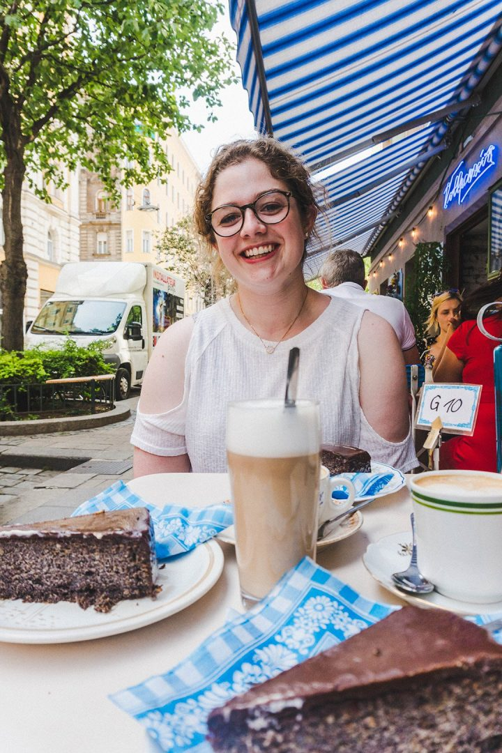 Astrid with cake and coffee at Cafe Vollpension in Vienna, Austria