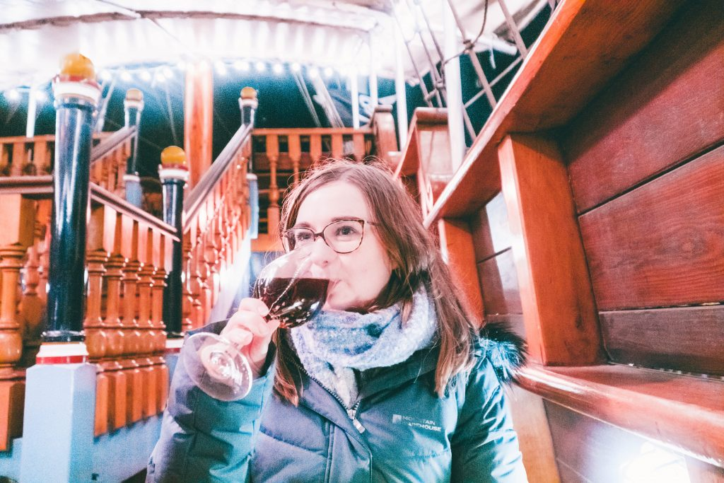 Addie sipping a glass of gløgg at Tivoli Gardens in Copenhagen