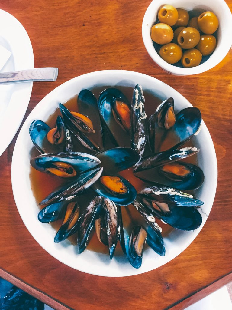 Mussels soaked in a spicy broth at La Pilareta in Valencia, Spain